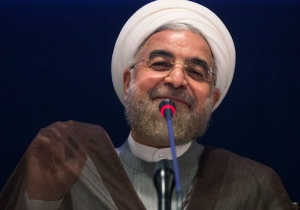 Iran's President Hassan Rouhani smiles while replying to a question during a news conference on the sidelines of the 69th United Nations General Assembly at United Nations Headquarters in New York